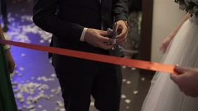 Cutting red ribbon on opening stock footage