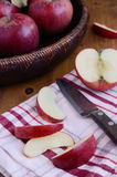 Cutting red ripe apple Royalty Free Stock Photo
