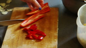Cutting red sweet pepper stock footage