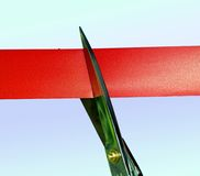 Cutting the red tape. Business metaphor or Opening Royalty Free Stock Photography