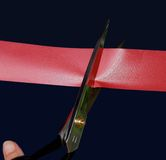 Cutting the red tape Royalty Free Stock Photo