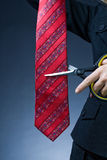 Cutting red tie Royalty Free Stock Photos