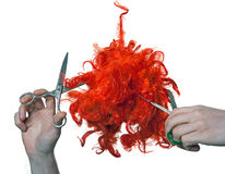 Cutting red wig Stock Photos
