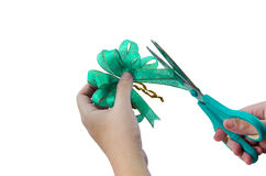 Cutting the ribbon. Green ribbon cutting isolated on white background Stock Photography