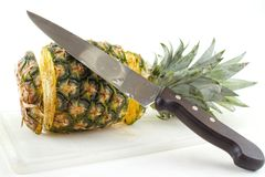 Cutting ripe pineapple Royalty Free Stock Image