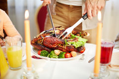 Cutting roasted poultry Stock Photos