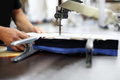 Cutting room. Cutting room, cutting cloth tailoring knife Royalty Free Stock Photos