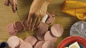 Cutting salami. Table top of cook hands cutting the salami stock video