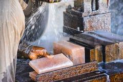Cutting Salt to make Tiles. Cutting natural salt to make Tiles with cutting machine – Somewhere near Quaidabad, Khushab, Punjab, Pakistan Royalty Free Stock Photography