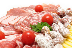 Cutting sausage and cured meat Stock Photography