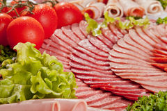 Cutting sausage and cured meat with a parsley Stock Photography