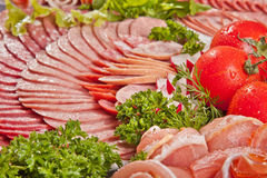 Cutting sausage and cured meat with a parsley Stock Photo
