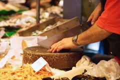 Cutting sea food at the market Royalty Free Stock Images