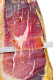 Cutting serrano ham Royalty Free Stock Photography