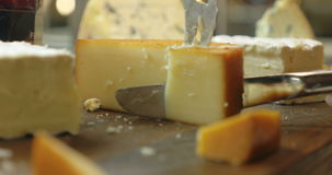 Cutting a Serving from the Cheese stock footage