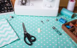 Cutting, sewing. White machine and various accessories. Cutting and sewing. White sewing machine and bright beautiful accessories stock images