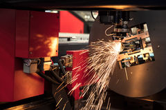 Cutting of sheet metal process with safety glass protection. Spa Stock Photo
