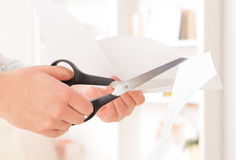 Cutting sheet of paper Royalty Free Stock Photo