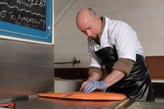 Cutting smoked salmon Stock Image