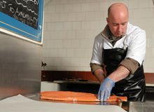 Cutting smoked salmon Stock Images