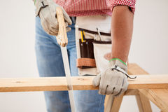 Cutting some wood boards Royalty Free Stock Image