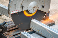 Cutting a square metal and steel with compound mitre Stock Photos