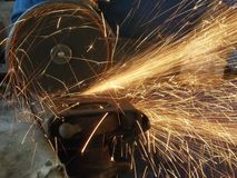Cutting steel. Angle grinder cutting steel Stock Images