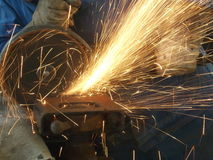 Cutting steel. Angle grinder cutting steel Royalty Free Stock Photos
