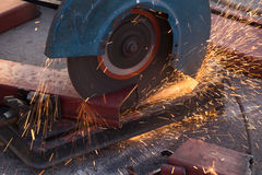 Cutting Steel channel (steel C chanel) with grinder Royalty Free Stock Photo