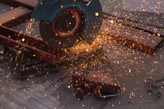 Cutting Steel channel (steel C chanel) with grinder Royalty Free Stock Photos