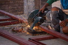 Cutting Steel channel (steel C chanel) with grinder Stock Images