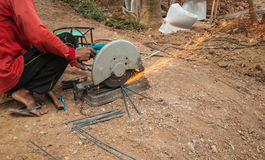 Cutting steel. Electric saws with hand grinder. Sparks while grinding iron Stock Photography