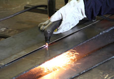 Cutting steel with gas. Steel plate cutting by gas machine Royalty Free Stock Images