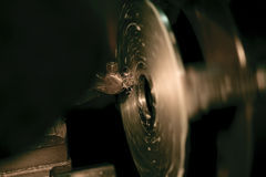 Cutting Steel gears on a lathe Royalty Free Stock Photo
