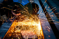 Cutting steel with grinder Royalty Free Stock Photo