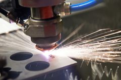 Cutting steel with a laser stock images