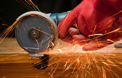 Cutting steel with a small grinder. With sparks flying Royalty Free Stock Photos