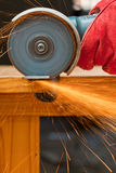 Cutting steel with a small grinder Royalty Free Stock Photography