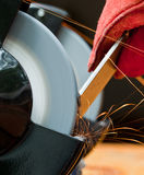 Cutting steel with a small grinder. With sparks flying Stock Image