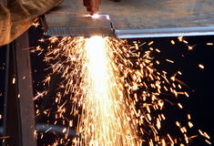 Cutting steel and sparks Stock Photography