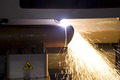 Cutting steel tube. An industrial background Machine, cutting steel tube on the factory Stock Photography