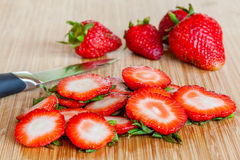 Cutting strawberries Royalty Free Stock Images