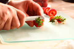 Cutting strawberries A Stock Images