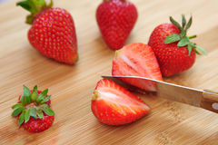 Cutting strawberry Royalty Free Stock Photography