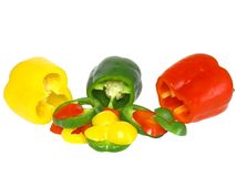 Cutting  sweet pepper on white . Isolated Stock Image