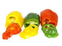 Cutting  sweet pepper on white . Isolated Royalty Free Stock Photos