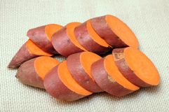 Cutting sweet potatoes Royalty Free Stock Photos