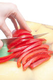 Cutting sweet red pepper Stock Photography