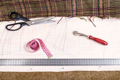 Cutting table with cloth, pattern, tailoring tools Royalty Free Stock Photos