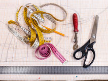 Cutting table with pattern and tailoring tools Royalty Free Stock Image